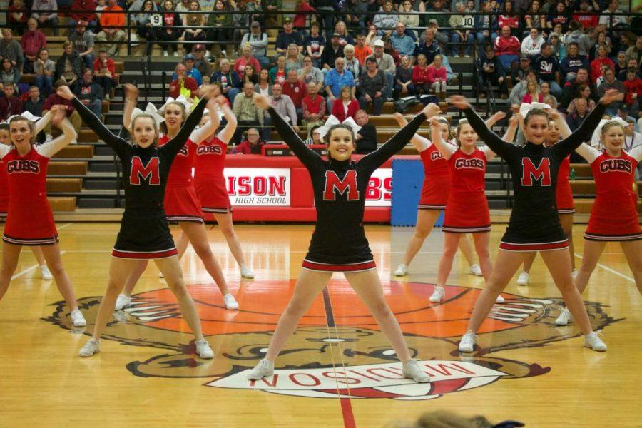 The Cubs cheerleaders perform between the girls' and boys' varsity games.