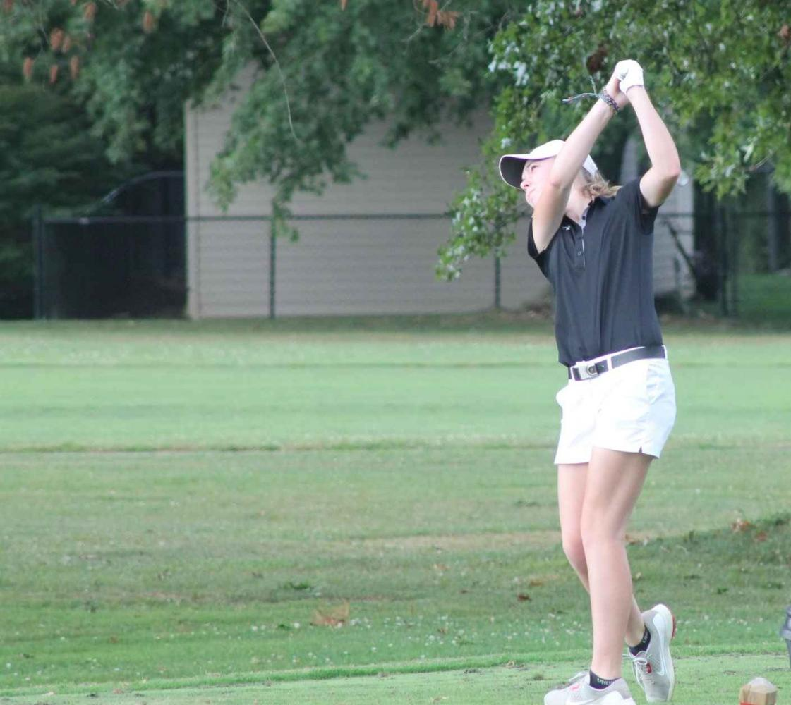 MCHS Senior Golfer Emma Beasley holds her finish.