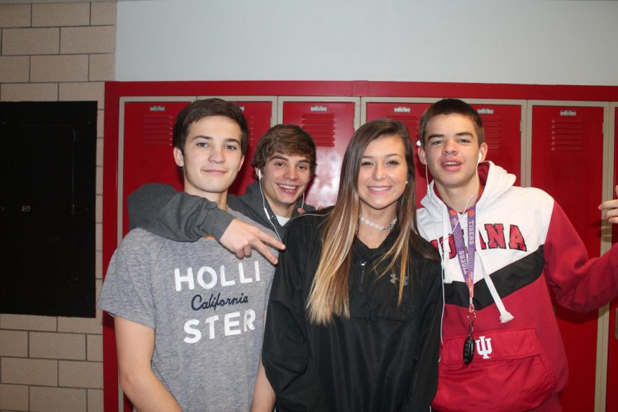 MCHS Sophomore Forward Hannah Imel with Lady Cubs Fans Landon Conner, Brayden Perry, and Blair Holt