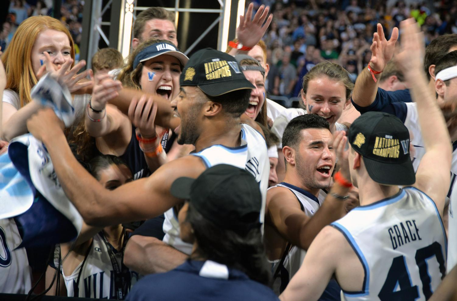 Villanova players and fans celebrate together after the Wildcats won the 2018 men's college basketball championship.