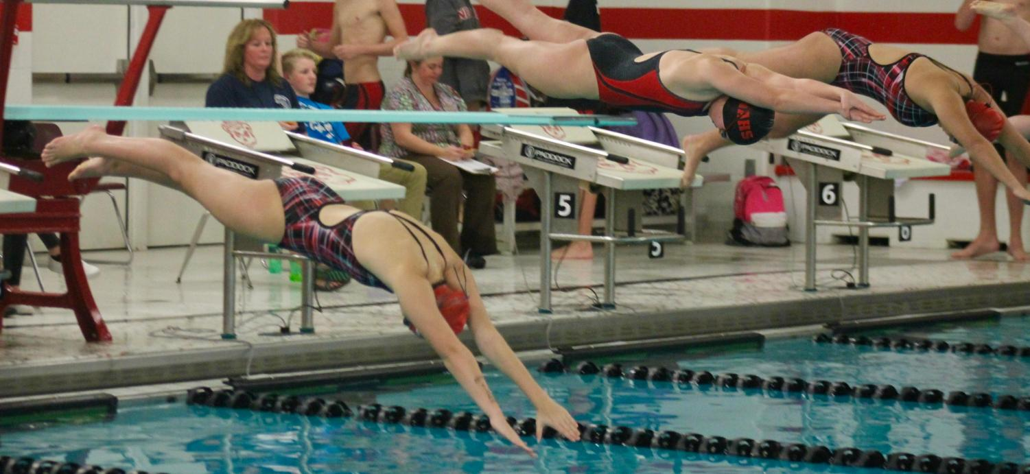 An MCHS swimmer is the  first off of the platform.
