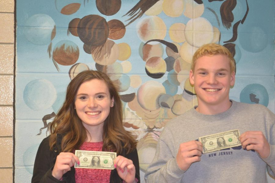 Seniors+Hannah+Huff+and+Eoin+McMahon+display+dollar+bills+after+winning+the+most+likely+to+be+a+millionaire+superlative.