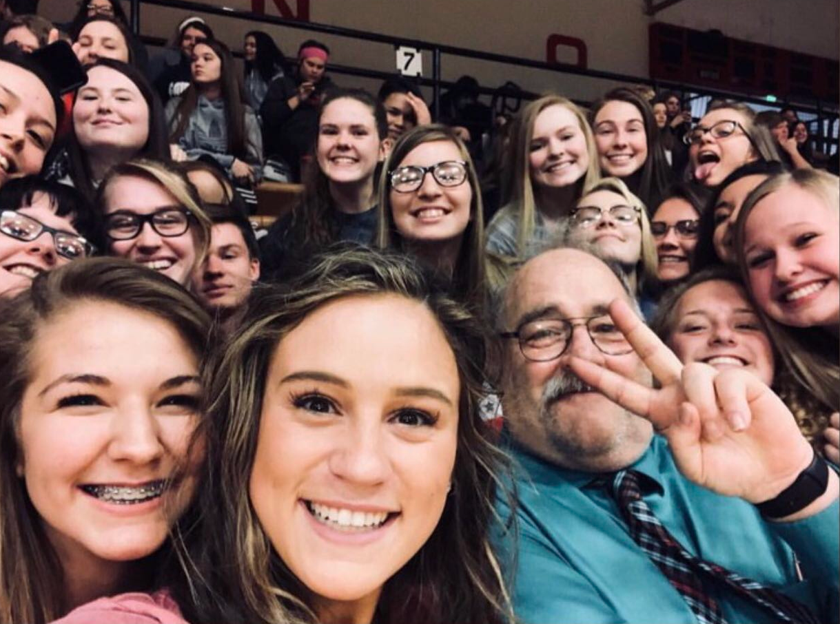 Mr. Rusk joins the student sections at a basketball game
