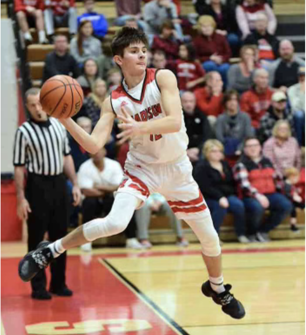 MCHS senior basketball player Luke Miller saves the ball from going out of bounds.