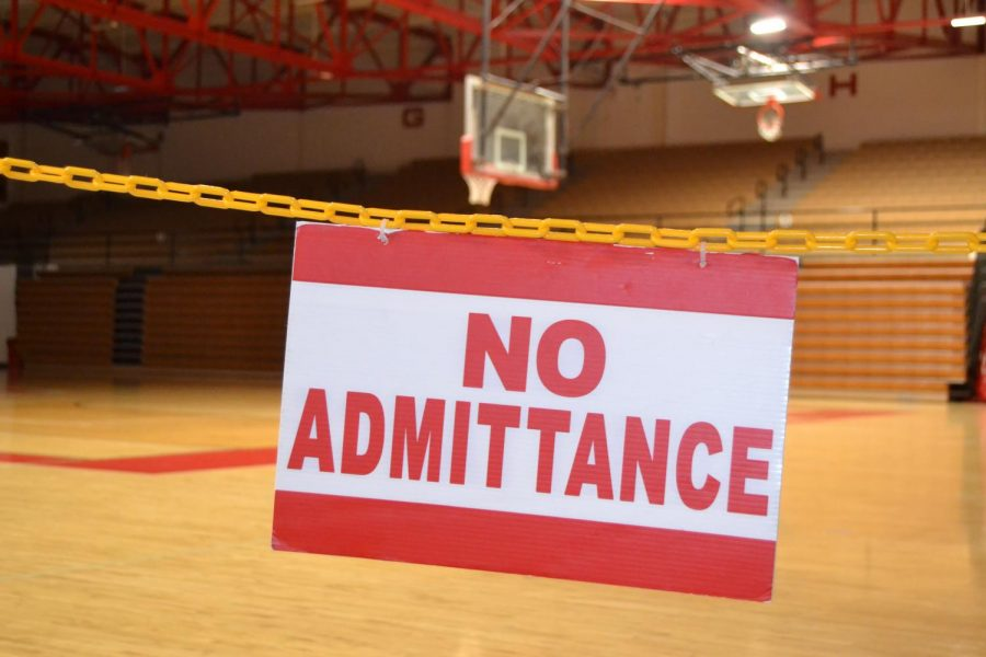 A no admittance sign hangs before an entrance to Connor K. Salm Gymnasium.