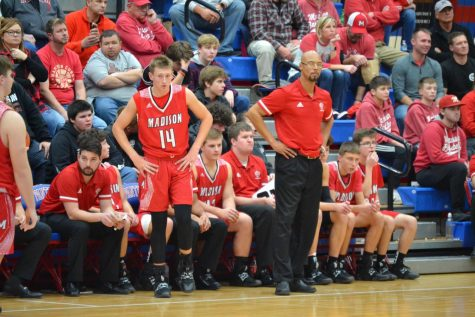 Senior forward Luke Ommen stands with Coach Sherron Wilkerson in a game last year.