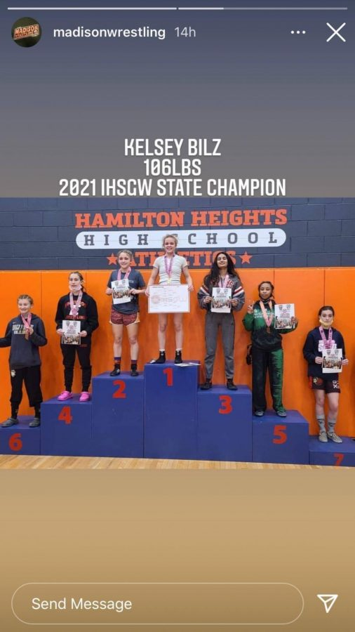 Kelsey+Bilz+stands+atop+the+podium+after+winning+the+female+wrestling+state+championship.