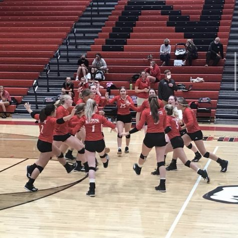 The Lady Cubs Volleyball team celebrates.