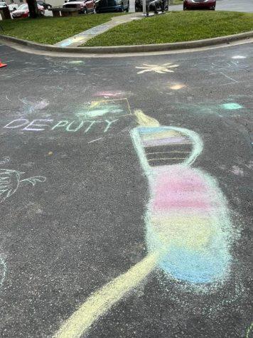 Sidewalk chalk art outside of Deputy elementary.